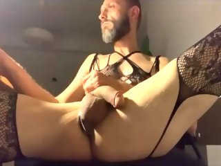 sexy Handsome and sexy bearded guy playing in women's lingerie handsome